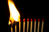 istock Group of red match burning isolated on black background. 1279186047