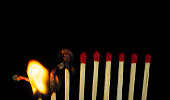 istock Group of red match burning isolated on black background. 1279186056