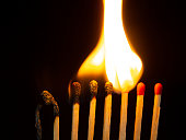 istock Group of red match burning isolated on black background. 1279186081