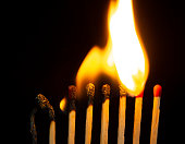istock Group of red match burning isolated on black background. 1279186136