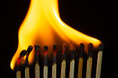 istock Group of red match burning isolated on black background. 1279186166