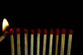 istock Group of red match burning isolated on black background. 1279186176
