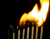 istock Group of red match burning isolated on black background. 1279186218