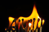 istock Group of red match burning isolated on black background. 1279186235
