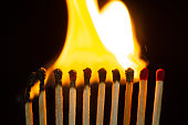 istock Group of red match burning isolated on black background. 1279186301