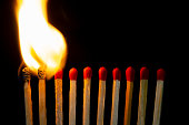 istock Group of red match burning isolated on black background. 1279186355
