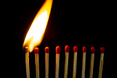 istock Group of red match burning isolated on black background. 1279186419