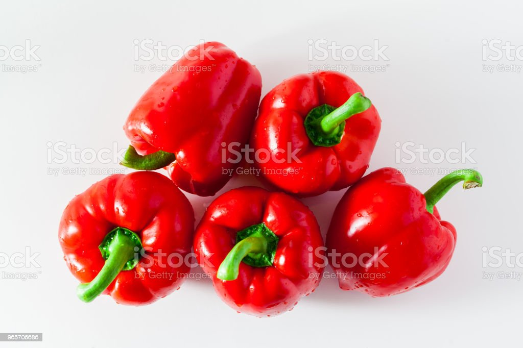 group of red ripe organic bell pepper and fresh basil leaves iso stock photo