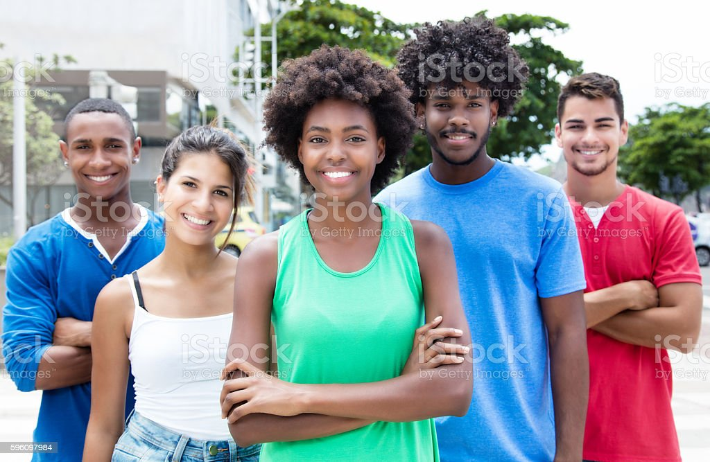 Group of relaxed mixed young adults in city Lizenzfreies stock-foto