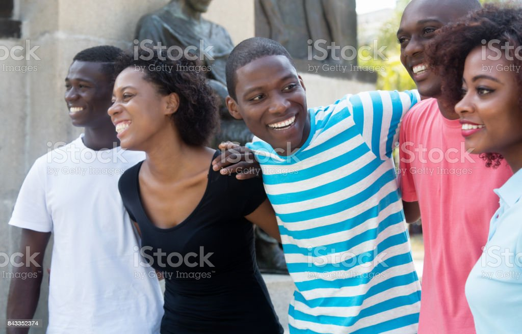 Group of relaxing african american man and woman in the city stock photo