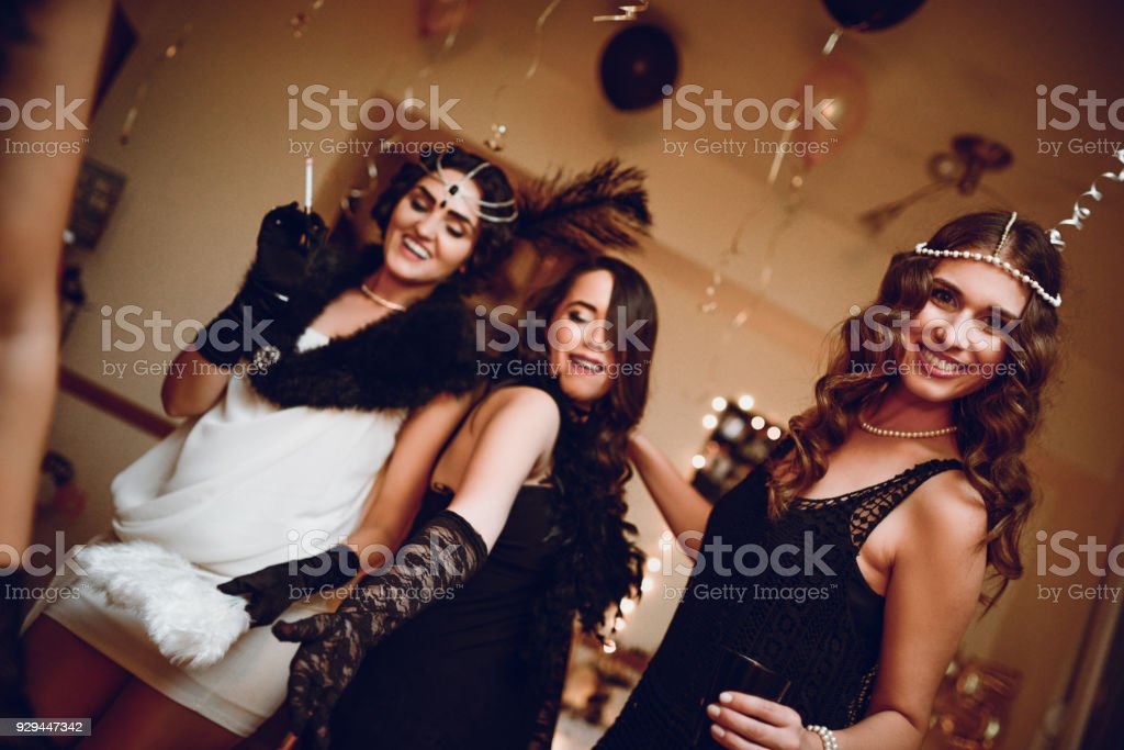 group of retro style fashion females posing at new years eve theme party royalty free