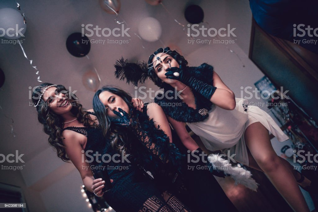 Group of Retro Style Fashion Females Posing at New Years Eve Theme Party stock photo