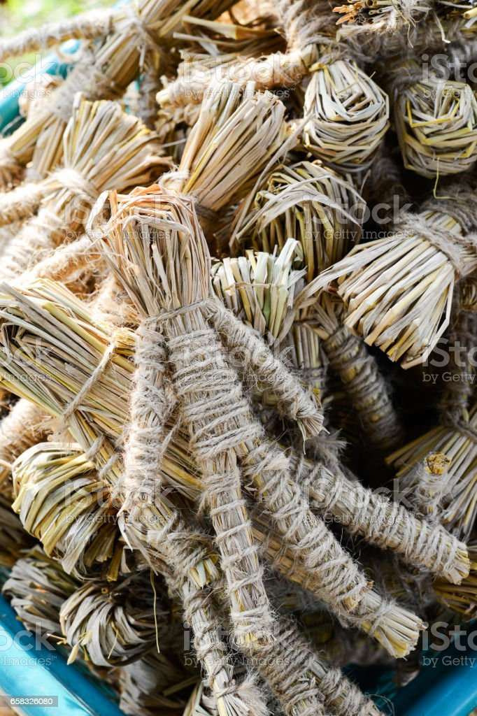 Group of rice straw puppets in basket stock photo