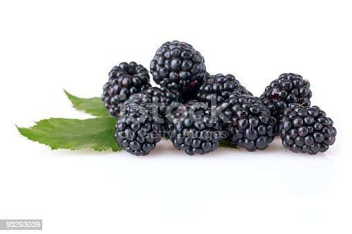 Pile of Blackberries with Leaf isolated on white background.