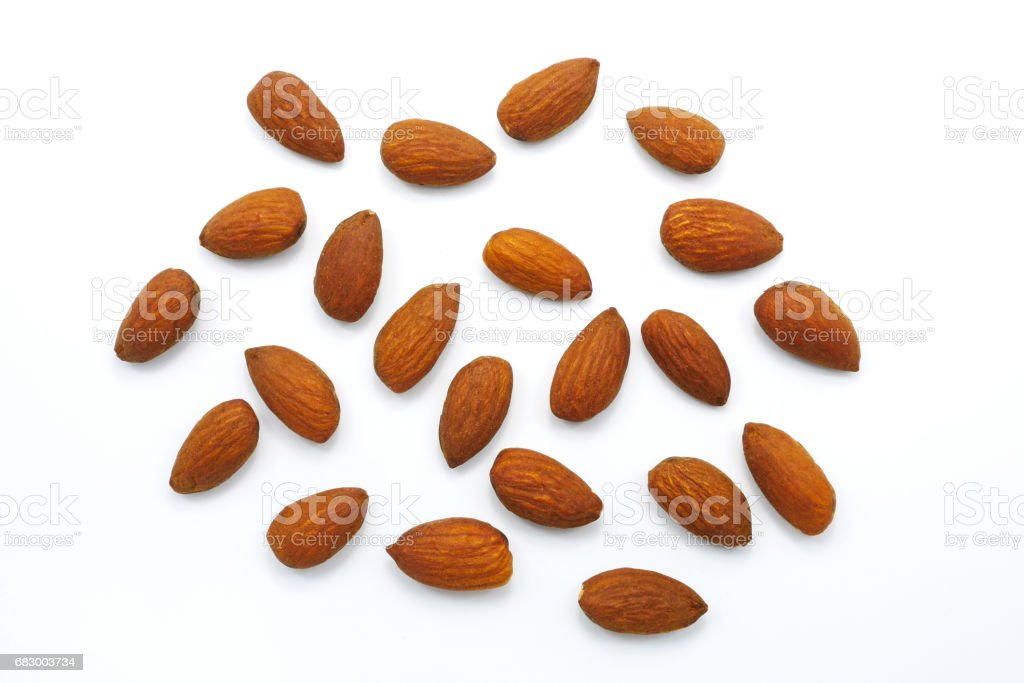 Group of roast almonds isolated on white background royalty-free stock photo