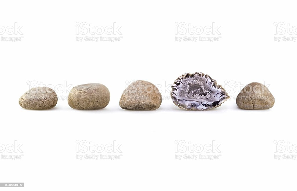 Group of rocks, one different from the rest royalty-free stock photo