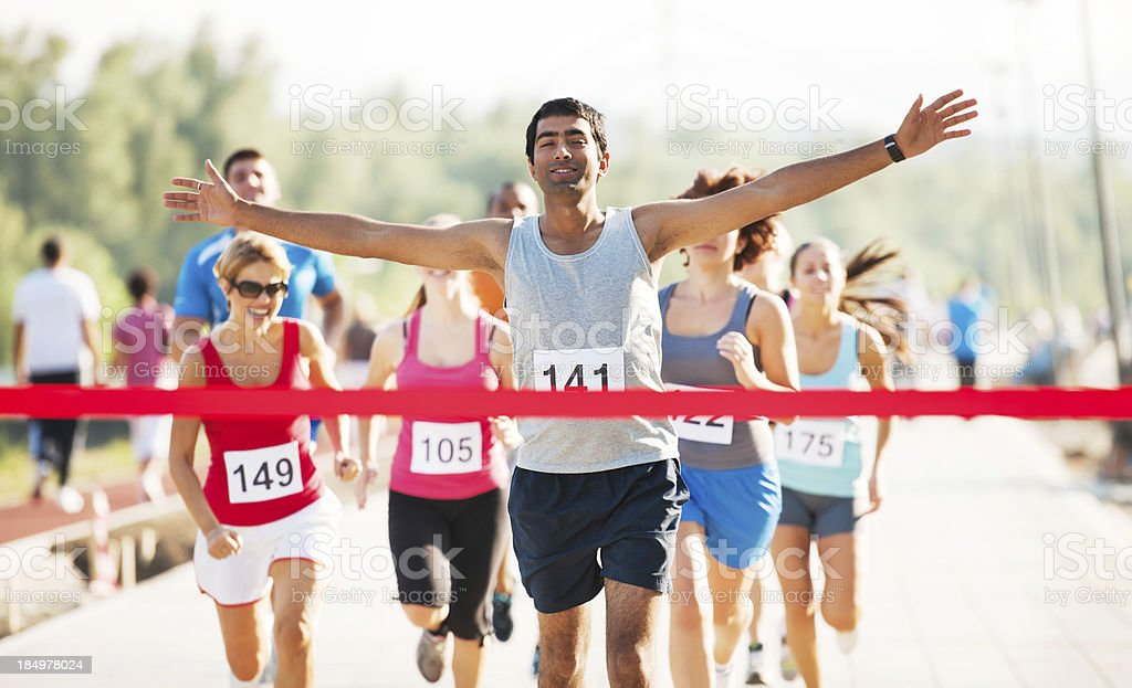 Group of runners finishing the cross country race. stock photo