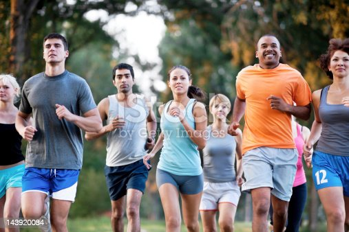 istock Group of runners in a cross country race. 143920084