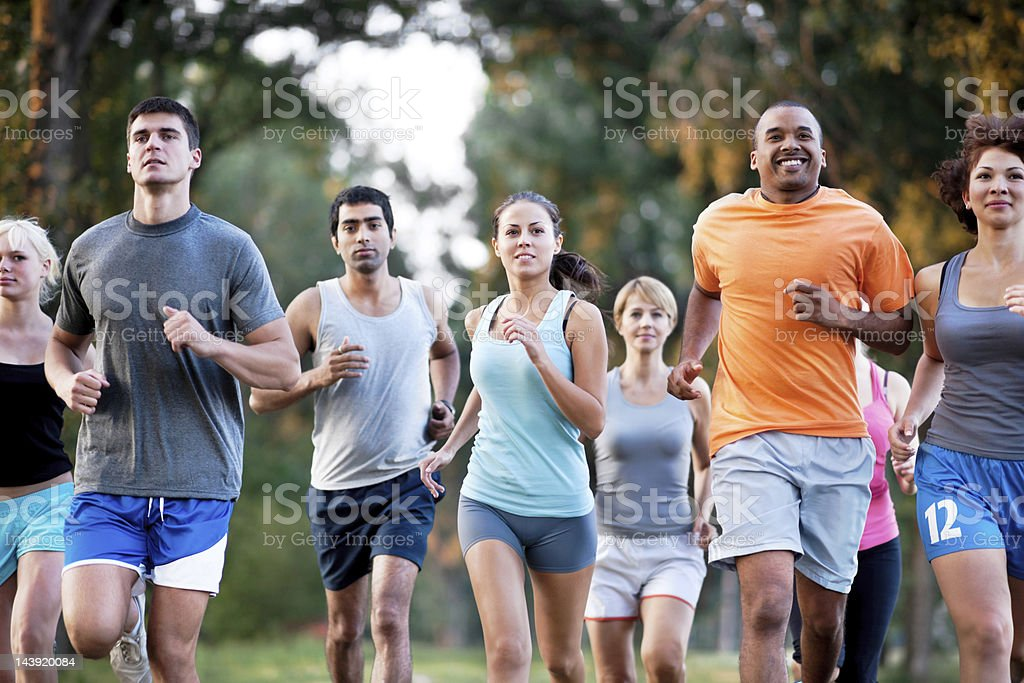 Group of runners in a cross country race. stock photo