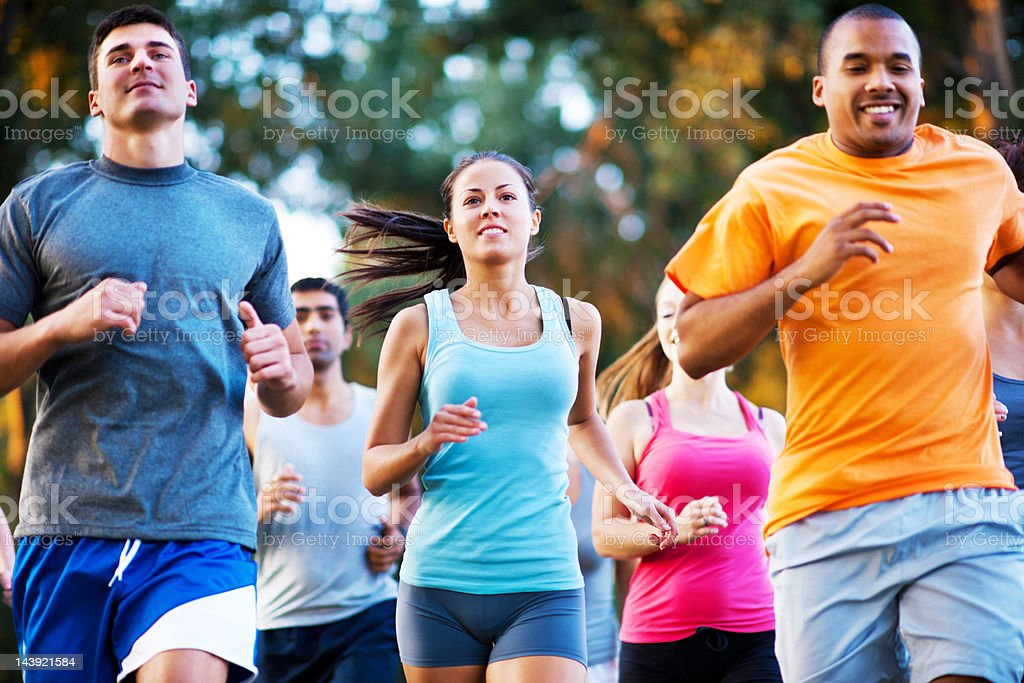 Group of runners in a cross country race royalty-free stock photo