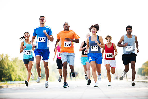 group of runners in a cross country race. - marathon stock photos and pictures