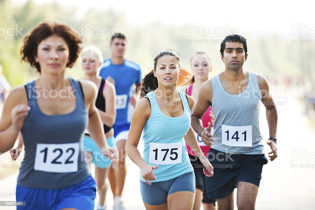Group of runners in a cross country race stock photo