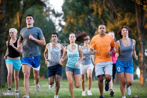 istock group of runners in a cross country race 184603775