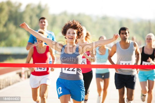 istock Group of runners in a cross country race. 184644402