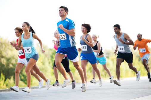 istock Group of runners in a cross country race. 184839421