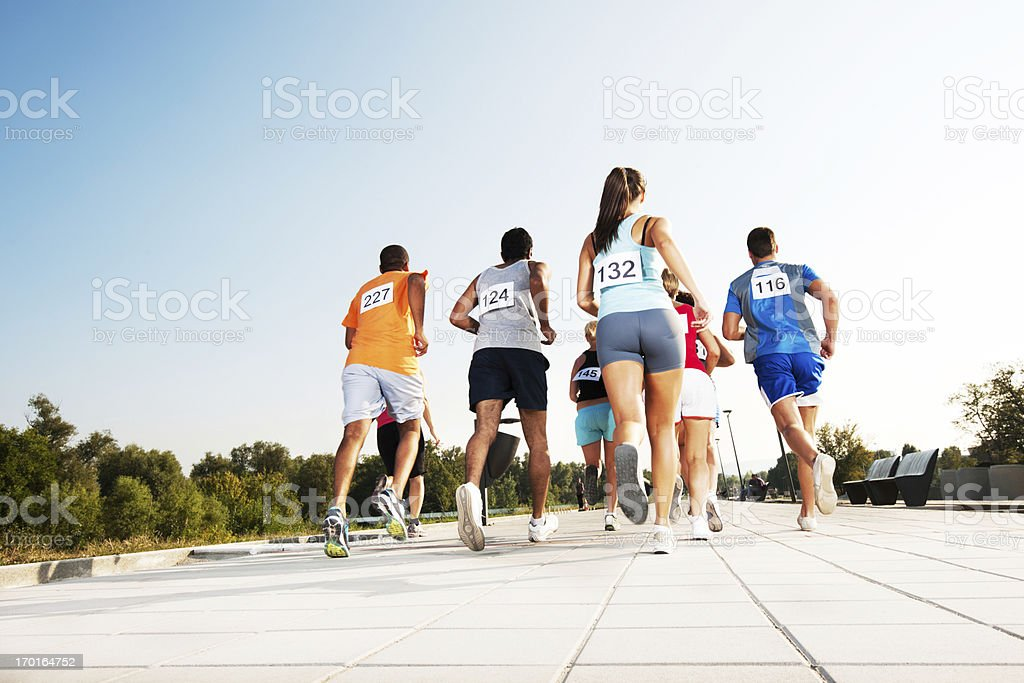 Group of runners in a marathon race - Royalty-free 10000 Meter Stock Photo