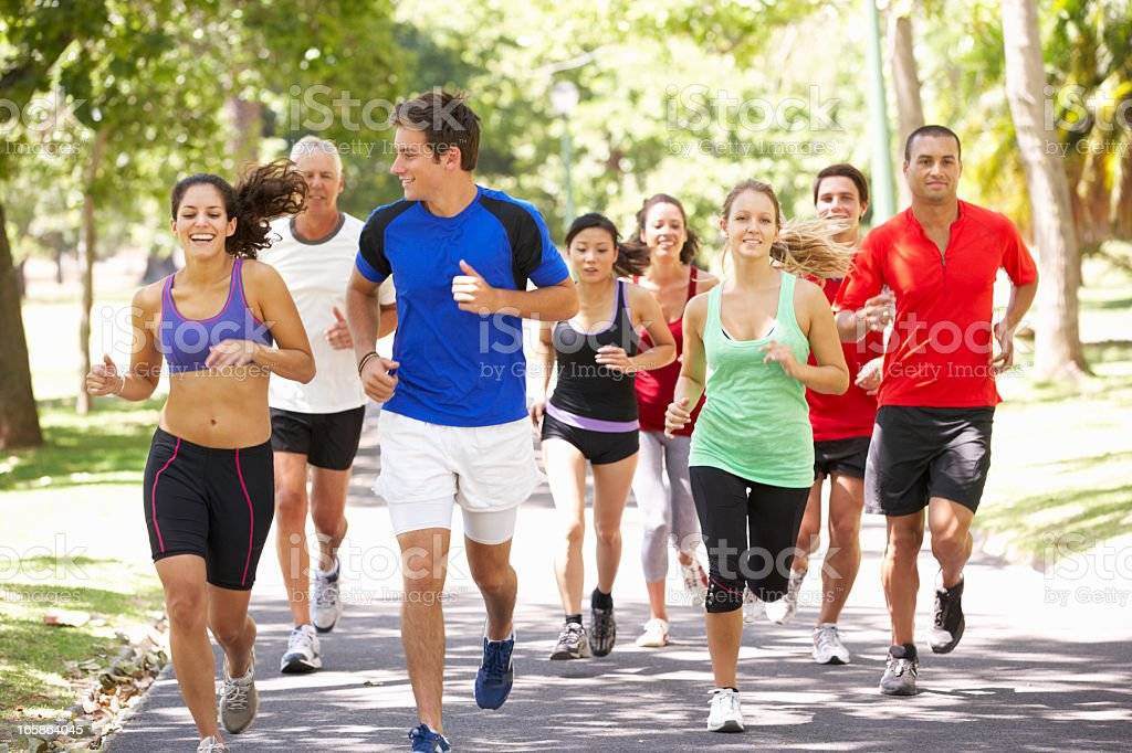Group Of Runners Jogging Through Park royalty-free stock photo