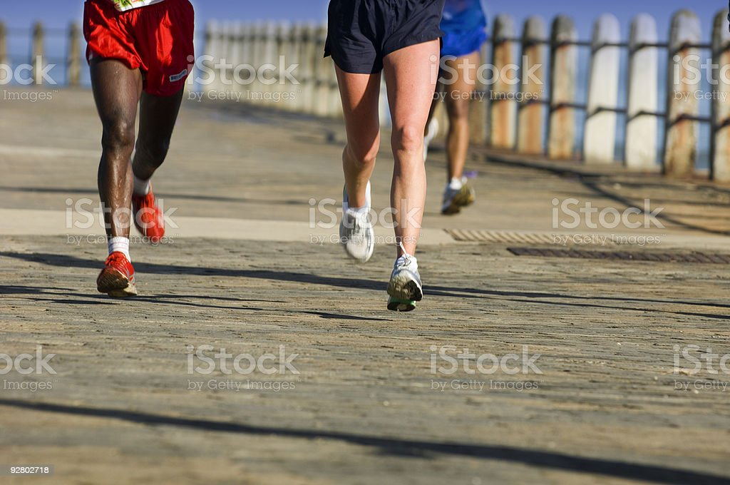Group of runners on a paved road royalty-free stock photo