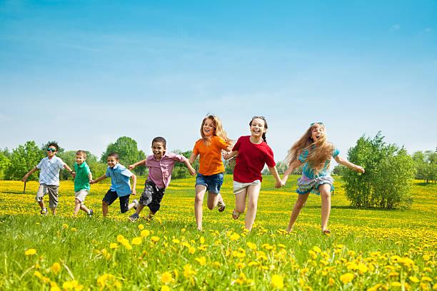 Group of running kids stock photo