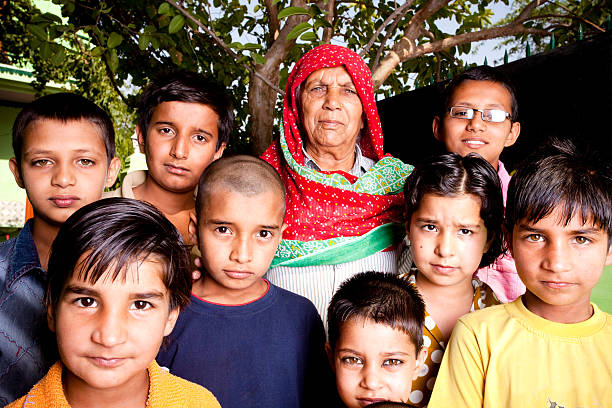 Group of Rural Indian Children with their Grandmother stock photo