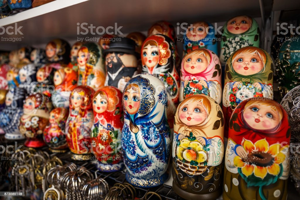 Group of Russian souvenir Matryoshka on store shelf - wooden toy in the form of a painted doll stock photo