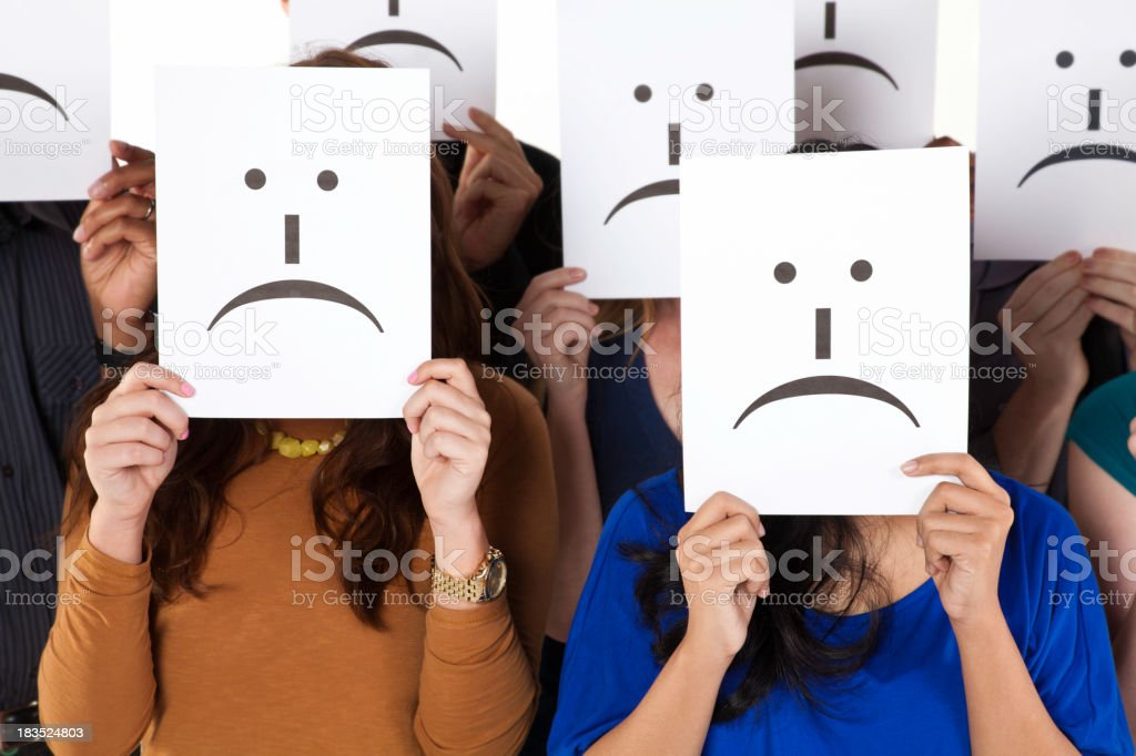 Group of Sad Face Emoticon Cards Being Held royalty-free stock photo