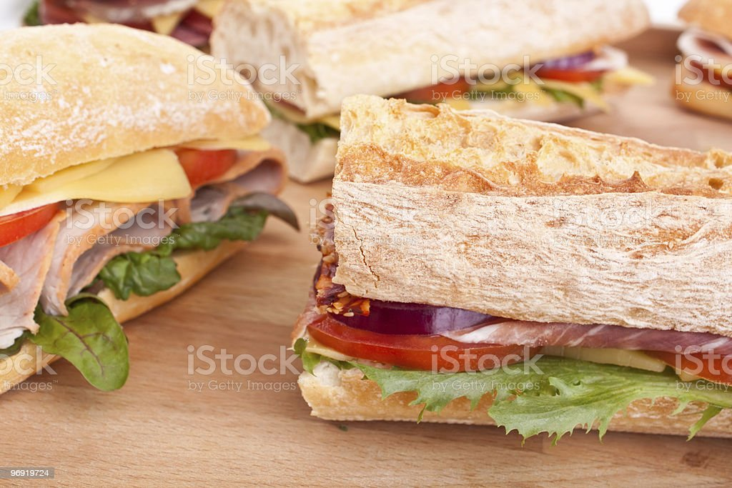 A group of sandwiches on a wooden surface royalty-free stock photo