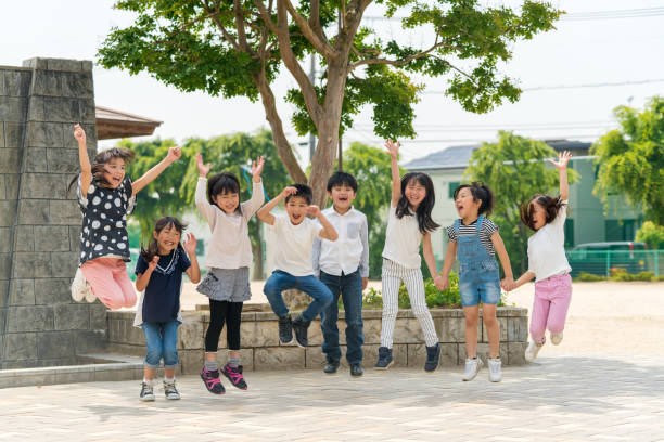 Group of school friends outdoors Group of school friends outdoors. Okayama, Japan japanese school girl stock pictures, royalty-free photos & images