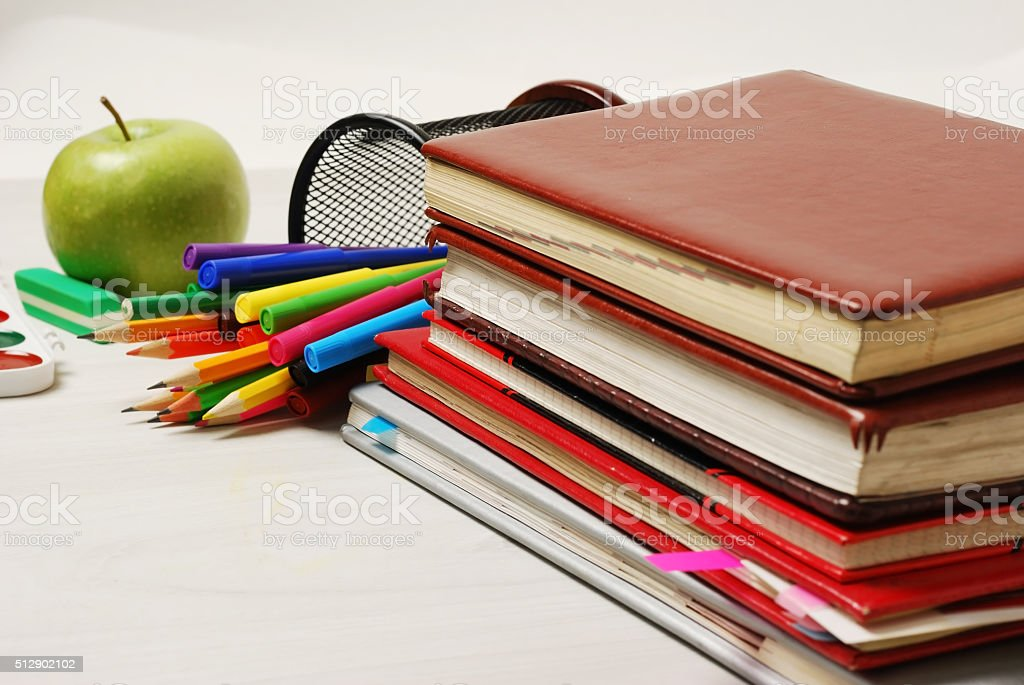 Group of school supplies, books, diaries, on a wooden table stock photo