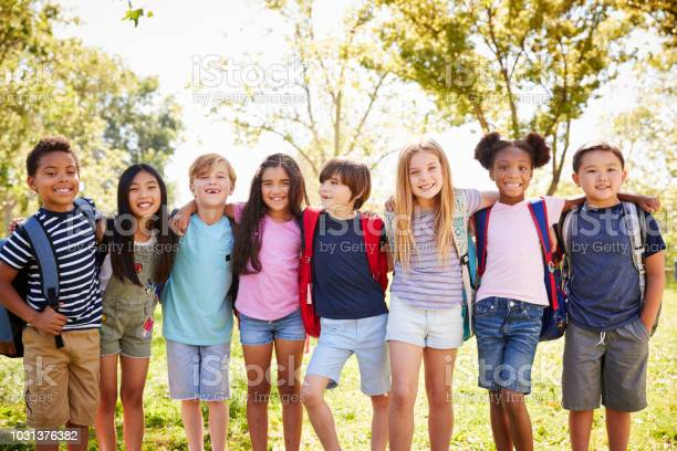 Group of schoolchildren stand embracing in a row outdoors picture id1031376382?b=1&k=6&m=1031376382&s=612x612&h=uqdglorlh4rgnodnrtby09b3nfmlrueilq0jvsdwatu=