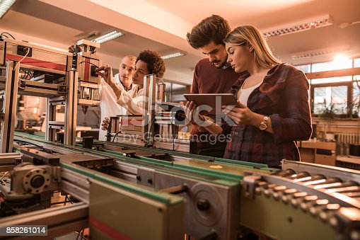 istock Group of scientist working on engineering project in a laboratory. 858261014