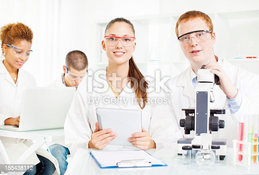 istock Group of Scientists at work in a lab. 155438112