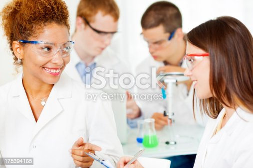 istock Group of Scientists at work in a lab. 175394165