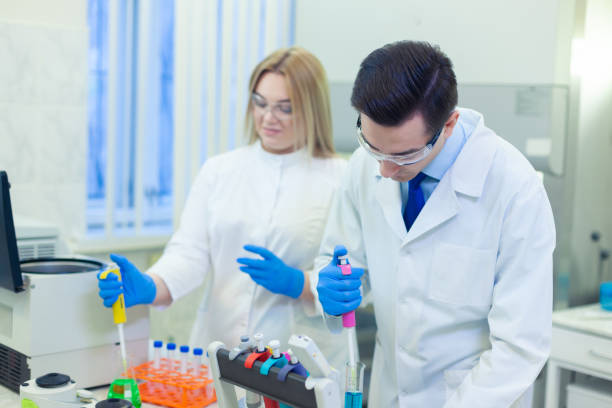 A group of scientists conducts research in a scientific laboratory using advanced technology. COVID-19. COVID Coronavirus stock photo