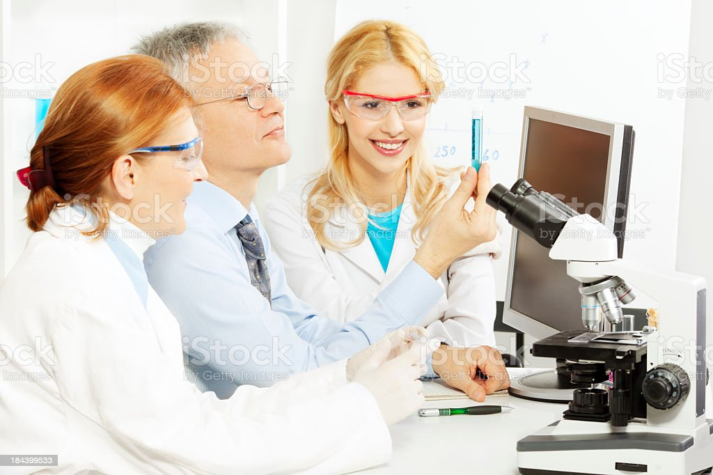 Group of scientists in a laboratory royalty-free stock photo