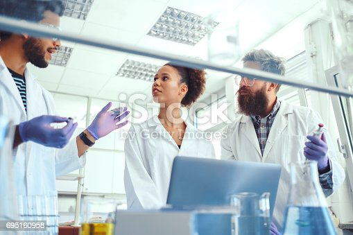 istock Group of scientists working in laboratory 695160958