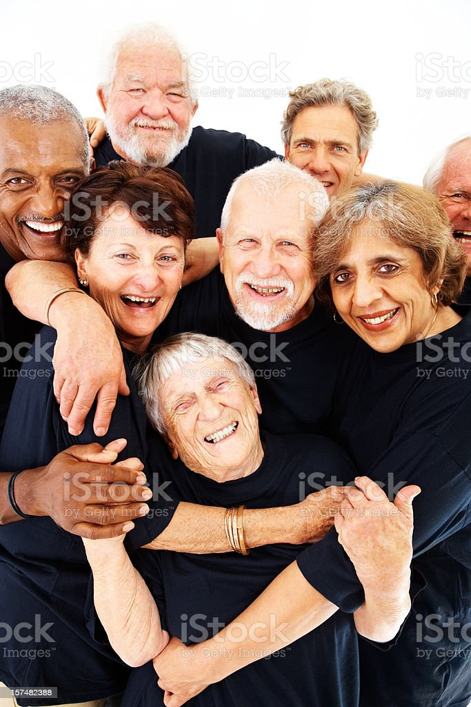 Group of senior citizens standing over white royalty-free stock photo