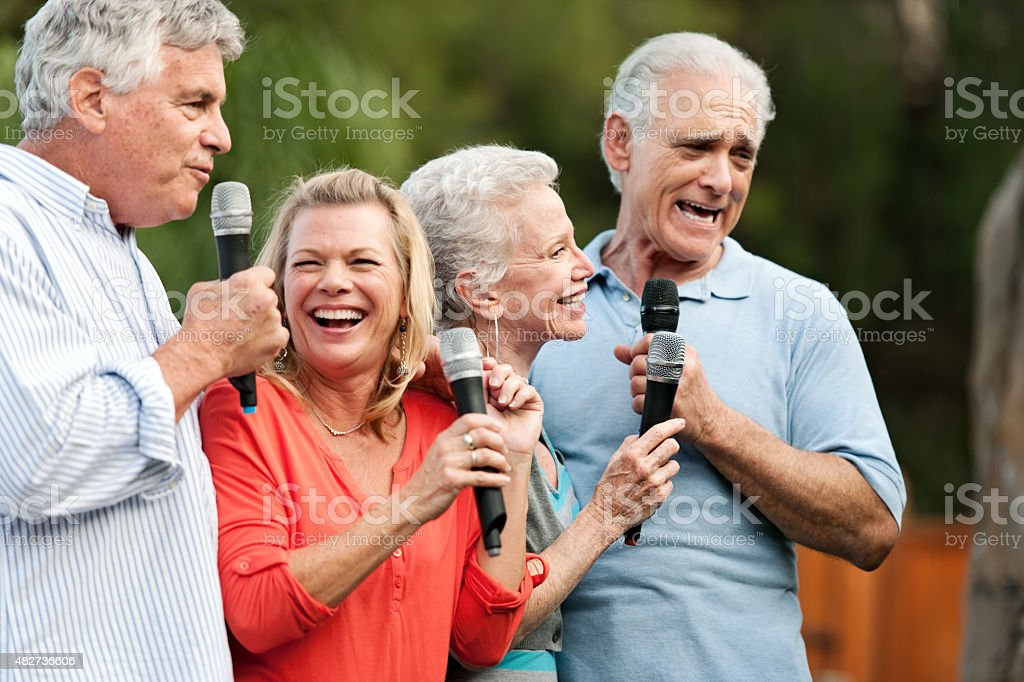 Group of senior friends having a party stock photo