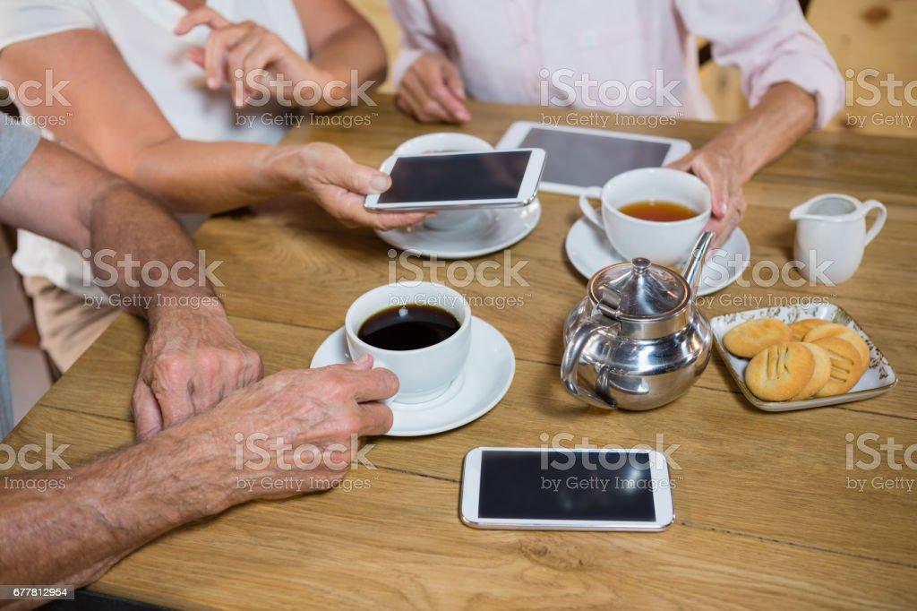 Group of senior friends having coffee royalty-free stock photo