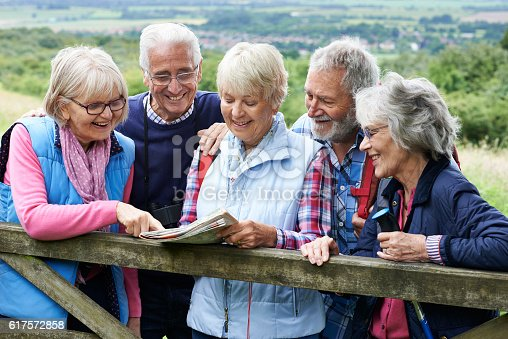 istock Group Of Senior Friends Hiking In Countryside 617572858
